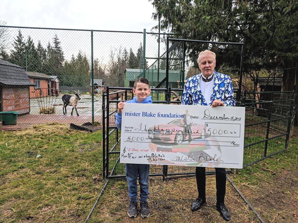mr. Blake and Matthew with a donation for $5,000